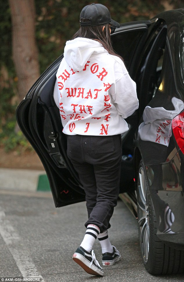 Kourtney Kardashian shows support for Kanye West by wearing his hoodie