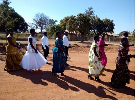 This Ugandan couple decided to save Money by trekking to Church on their wedding day (photos )