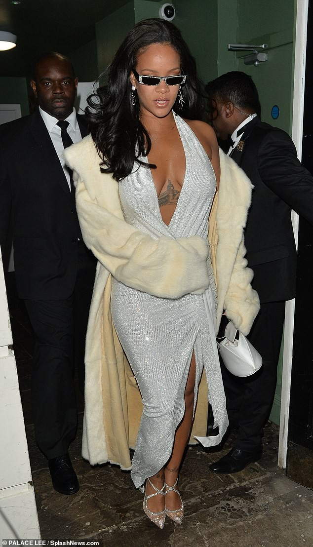 Rihanna goes braless in plunging silver dress for New Year's Eve celebrations in London (Photos)