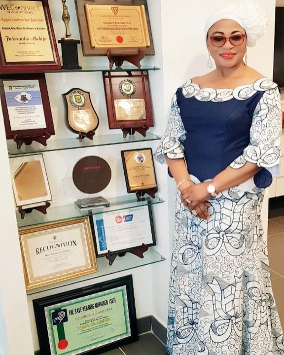 Nigeria's Richest Woman, Alakija, Gorgeous In Native Wear, Poses With Her Many Awards