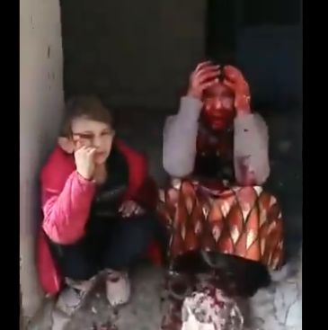 Heartbreaking video shows two children's reaction after their father, grandmother and great aunt were killed as Maarat al-Numan market was hit by a Russian bomber