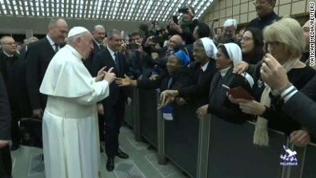 Pope Francis kisses nun after asking her 'Calm yourself, promise you won't bite?' (video)