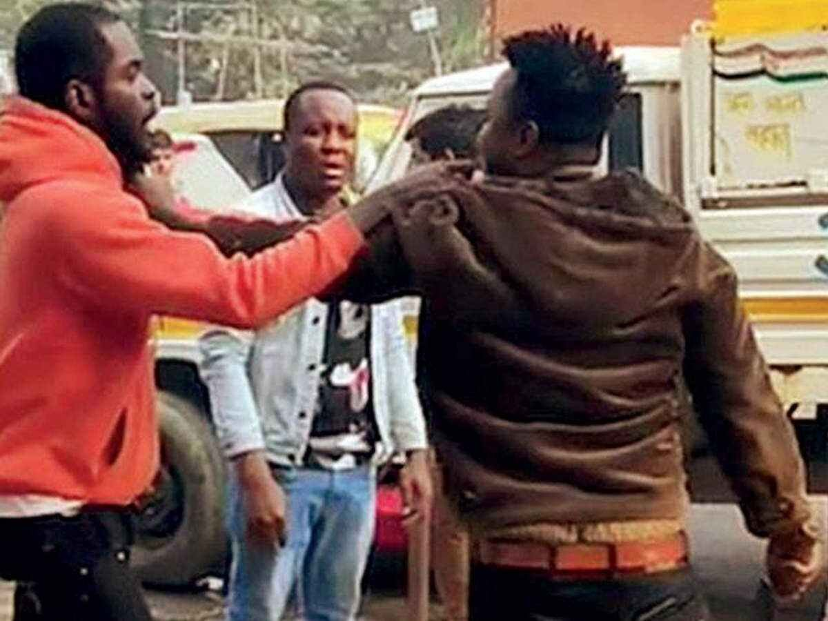 To escape deportation, two Nigerian nationals living illegally in India stage fake fight in crowded market to land themselves in jail (photos/video)