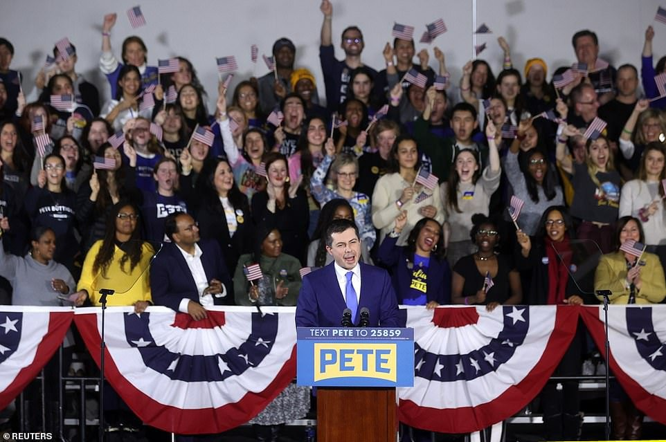 Pete Buttigieg hugs his husband after 'victory' in Iowa amid Democratic vote fiasco while Bernie Sanders publishes his results claiming winner too