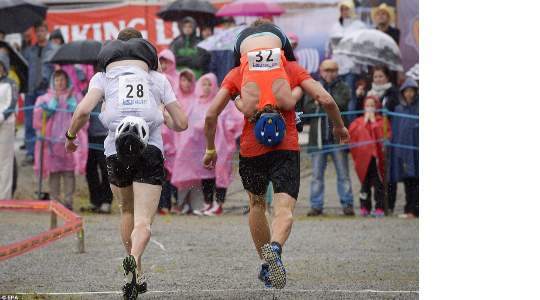 WIFE CARRYING!! If You Are Strong Enough To Carry Your Wife On Your Back While Running Through Some Obstacles, You Would Find This Tradition Interesting