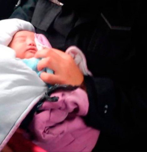 Newborn baby girl found in bin bag with knife sticking out of her back