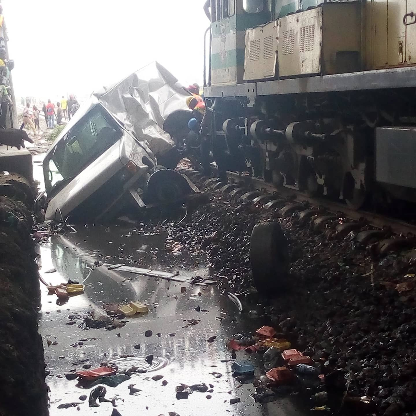 Passengers narrowly escape death as commercial bus collides with moving train in Lagos (photos/video)