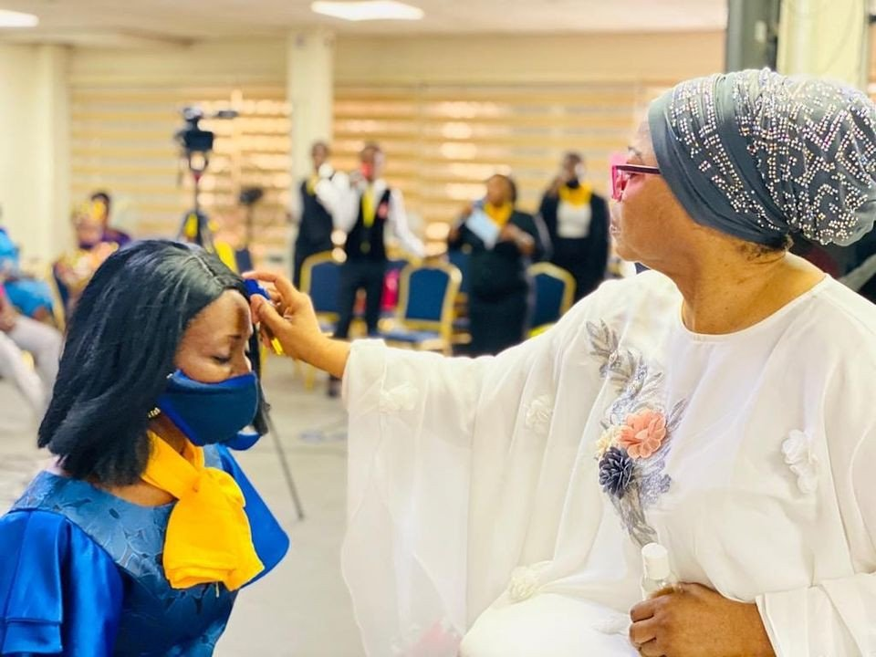 Billionaire businesswoman Folorunso Alakija pictured anointing her church members with olive oil