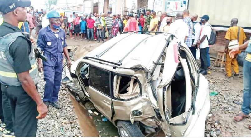Train Crushes Lagos Trader To Death While Attempting To Save Son Trapped In SUV (Photo)