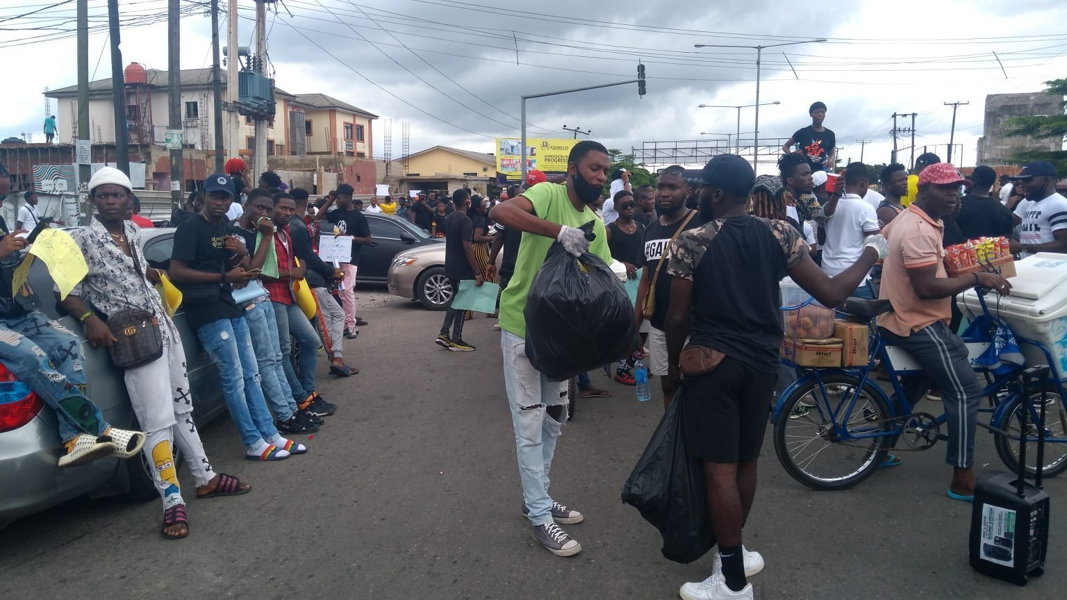 EndSARS: See The Young Nigerian Who Gathers Empty Cans, Bottles, Sachets, Clean Environment After Protests