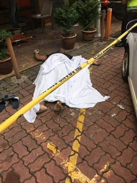 Young Nigerian Man Slumps, Dies In Malaysia (Graphic Photos)