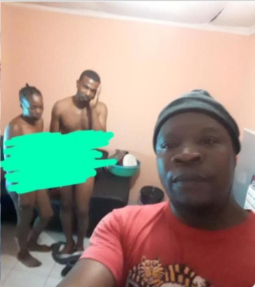 Man takes a selfie of himself with his cheating wife and best friend after he caught them in the act