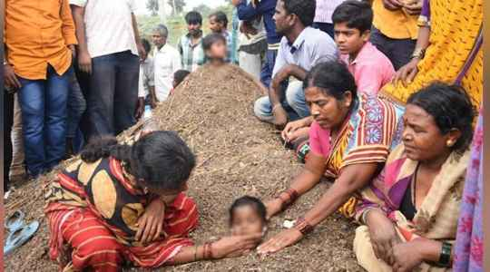 SHOCKING!! See Why Parents In India Bury Their Children Neck-Deep In Cowdung During Solar Eclipse😲