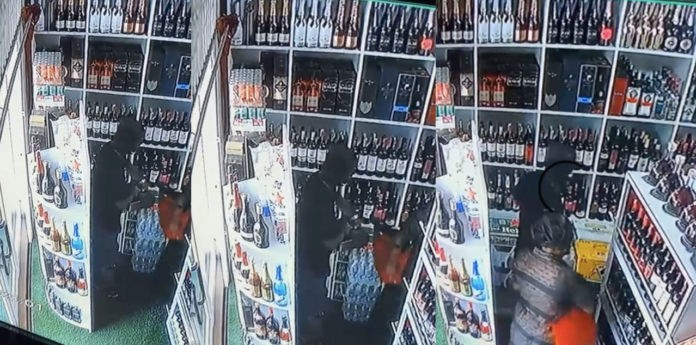 CCTV footage captures mother and son shop-lifting in a wine shop