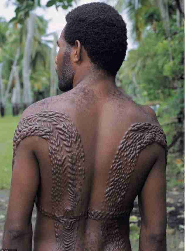 OMG!!! See Papua New Guinea's Bloody Male Initiation Rite Of Scarring Boys To look Like Crocodiles
