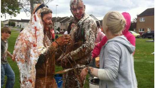 EWWW! Watch Strange Pre-wedding Tradition In Scotland Where Friends Bathe The Couple In Dirt Before Their Big Day