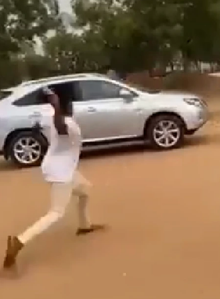 'Temple run': Watch moment rector escapes as students gather to beat him