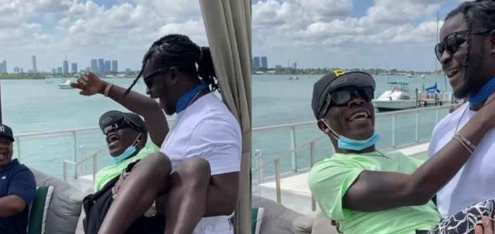 Funny video of Jupitar craddling Shatta Wale like a baby