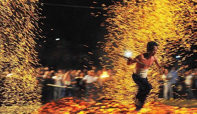 See Why Chinese People Run Across Hot Burning Charcoal At Night